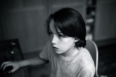 Pensive Boy @ Computer