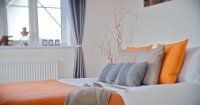 bedroom orange and tweed